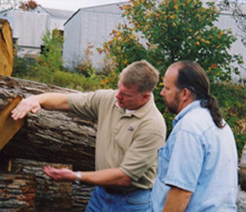 Pat Hunt evaluating uncut lumber